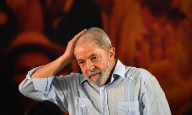 x74478081_Former-Brazilian-president-Luiz-Inacio-Lula-da-Silva-gestures-during-a-campaign-rally-to-la.jpg.pagespeed.ic.gT-3JzSSn-